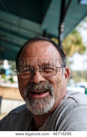 Old Scruffy Guy Laughing