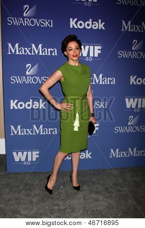 LOS ANGELES - JUN 12:  Rose McGowan arrives at the Crystal and Lucy Awards 2013 at the Beverly Hilton Hotel on June 12, 2013 in Beverly Hills, CA