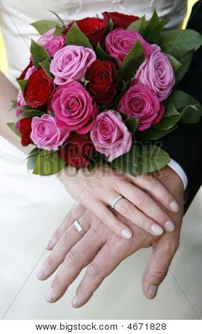 Wedding Rings And Bride Bouquet