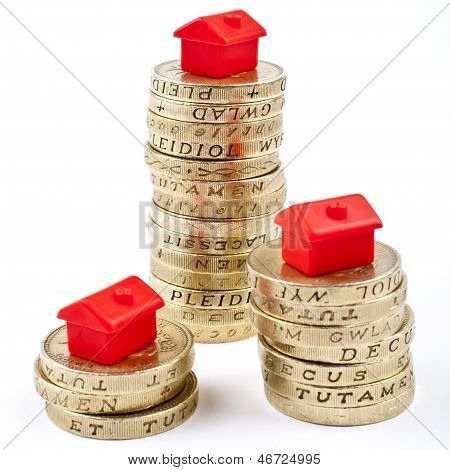 �1 Coins Stacked In Three Piles