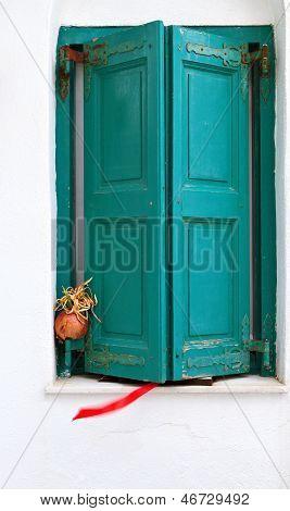 Old window at Mykonos, Greece