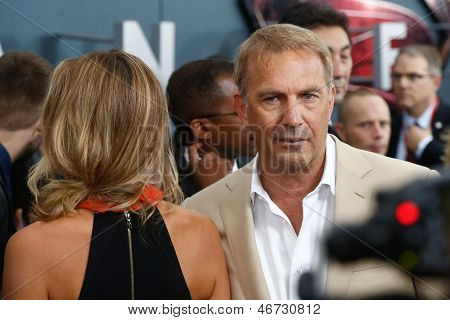 "NEW YORK-JUNE 10: Actor Kevin Costner and wife Christine Baumgartner attend the world premiere of ""Man of Steel"" at Alice Tully Hall at Lincoln Center on June 10, 2013 in New York City."