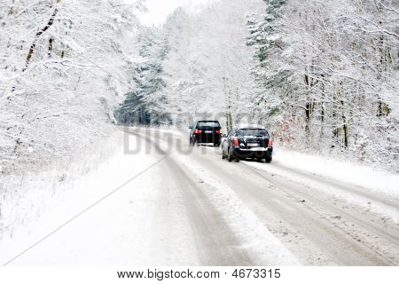 Cars On A White Winter Road
