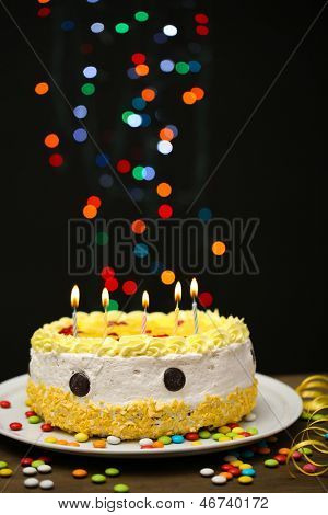 Happy birthday cake, on black background