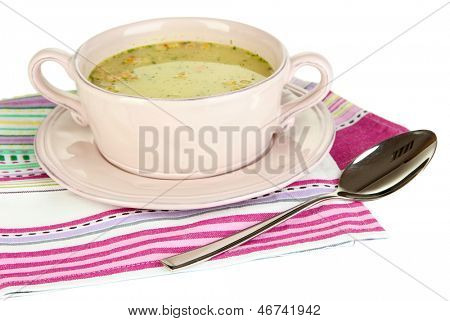 Nourishing soup with vegetables in pan isolated on white