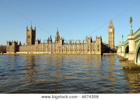 Palace Of Westminster, Over The Thames, With Big Ben And Westminster Bridge On The Right, In Golden