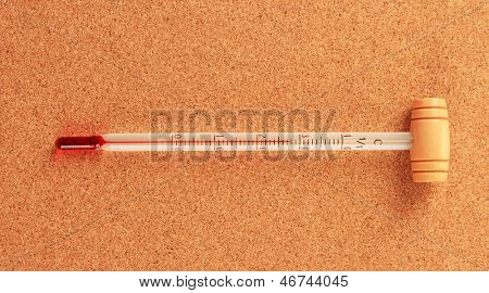 Wine thermometer on cork background