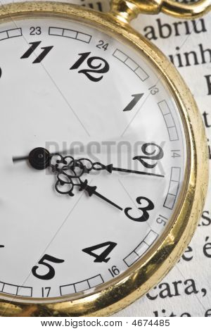 Classic Pocket Watch On Book