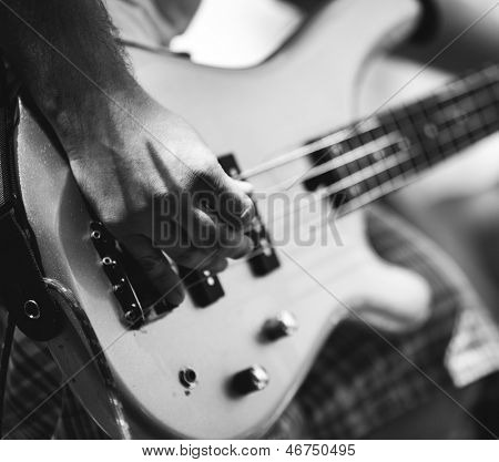 play on guitar, selective focus on part of hand
