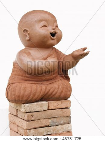 child monk isolated on white background