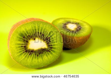 Close Up A Half Of Wiki Fruit With Isolated On Green Background