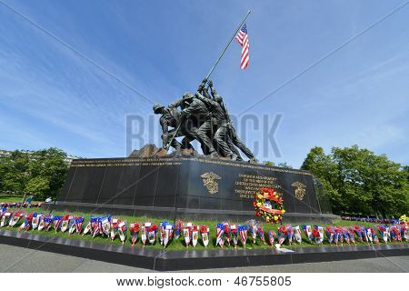 WASHINGTON DC - CIRCA MAY 2013: Iwo Jima Memorial circa May 2013 in Washington DC, USA. The Memorial framed with flower bouquets during Memorial Day week.