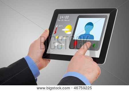 Businessman using tablet to video conference, meet online.