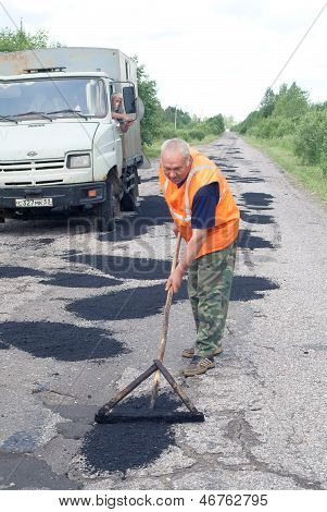 Repair of asphalt blade road