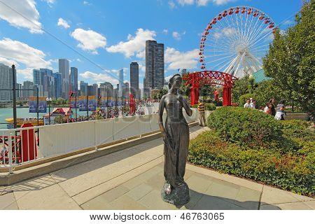 Statue, Ferris Wheel And Cityscape At Navy Pier In Chicago, Illinois
