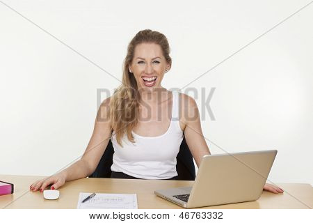 Female Business Executive Laughing Loudly