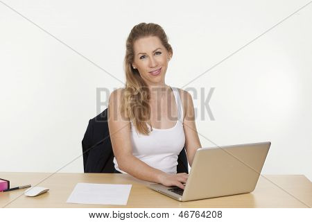 Female Business Executive Working On Laptop