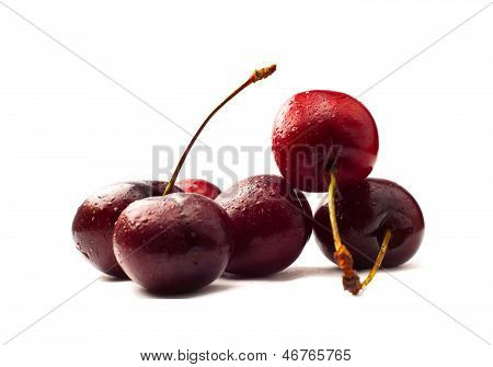 Fresh cherries isolated on white