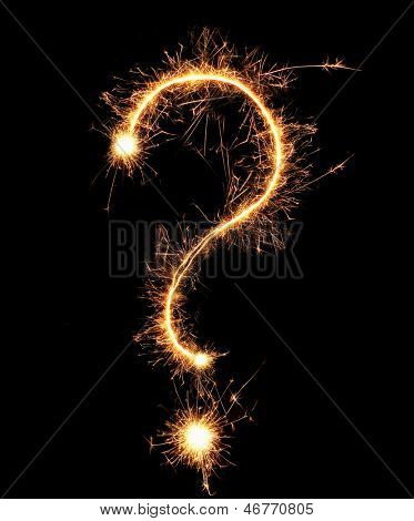 Question mark sparklers on black background