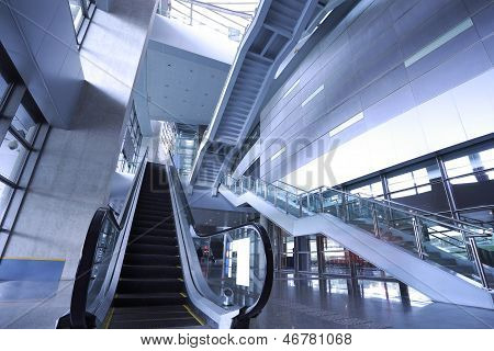 Modern Architecture Steps Of Moving Business Escalator And Stairs