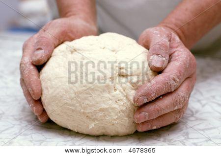 Hands Of Woman Baker Kneading Dough