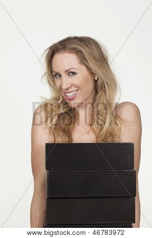 Smiling Female Carrying Office Folders