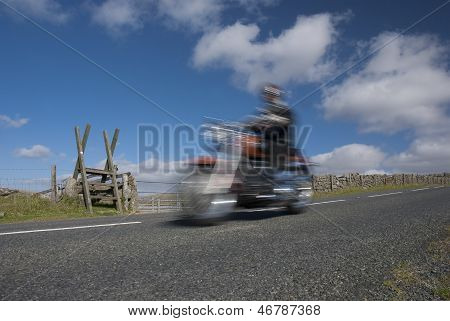 Classic Motorcycle Speeding On Mountain Road