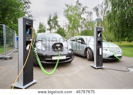 MOSCOW - AUGUST 18: Two electric cars recharged at electrical charging at festival Ekofest 2012 on banks of Stroginsky gulf, on August 18, 2012 in Moscow, Russia.