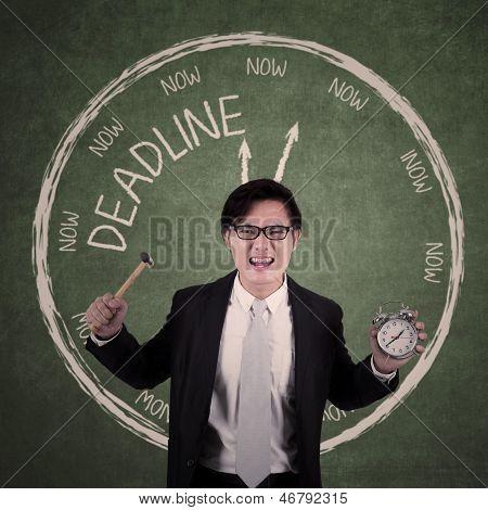 Crazy Businessman Holding Alarm Clock With Deadline