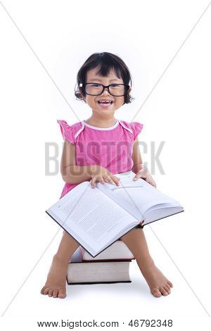 Cute Girl Reading Book On White
