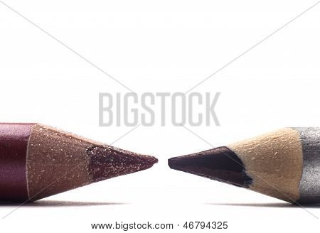 Two cosmetic pencils isolated on white