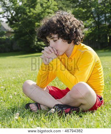 Hispanic Child Praying Outdoors