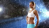 picture of light weight  - Fitness young woman standing under rain drops - JPG