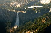 pic of glider  - Aerial view of waterfall and forest in Yosemite National Park with hang glider in foreground viewed from Glacier Point California U - JPG