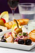 stock photo of ouzo  - greek salad of grilled octopus with wine - JPG