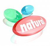 stock photo of over counter  - The word Natural on a pill - JPG