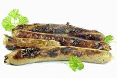 grilled sausage Bratwurst on the white background