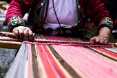 stock photo of loom  - Traditional hand weaving in the Andes Mountains Peru - JPG