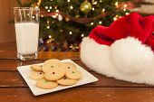pic of shortbread  - Plate of shortbread cookies with a glass of milk and Santa hat - JPG
