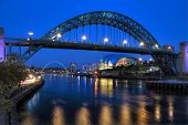 stock photo of tyne  - Newcastle Bridge spanning the River Tyne at night reflected in the river tyne - JPG