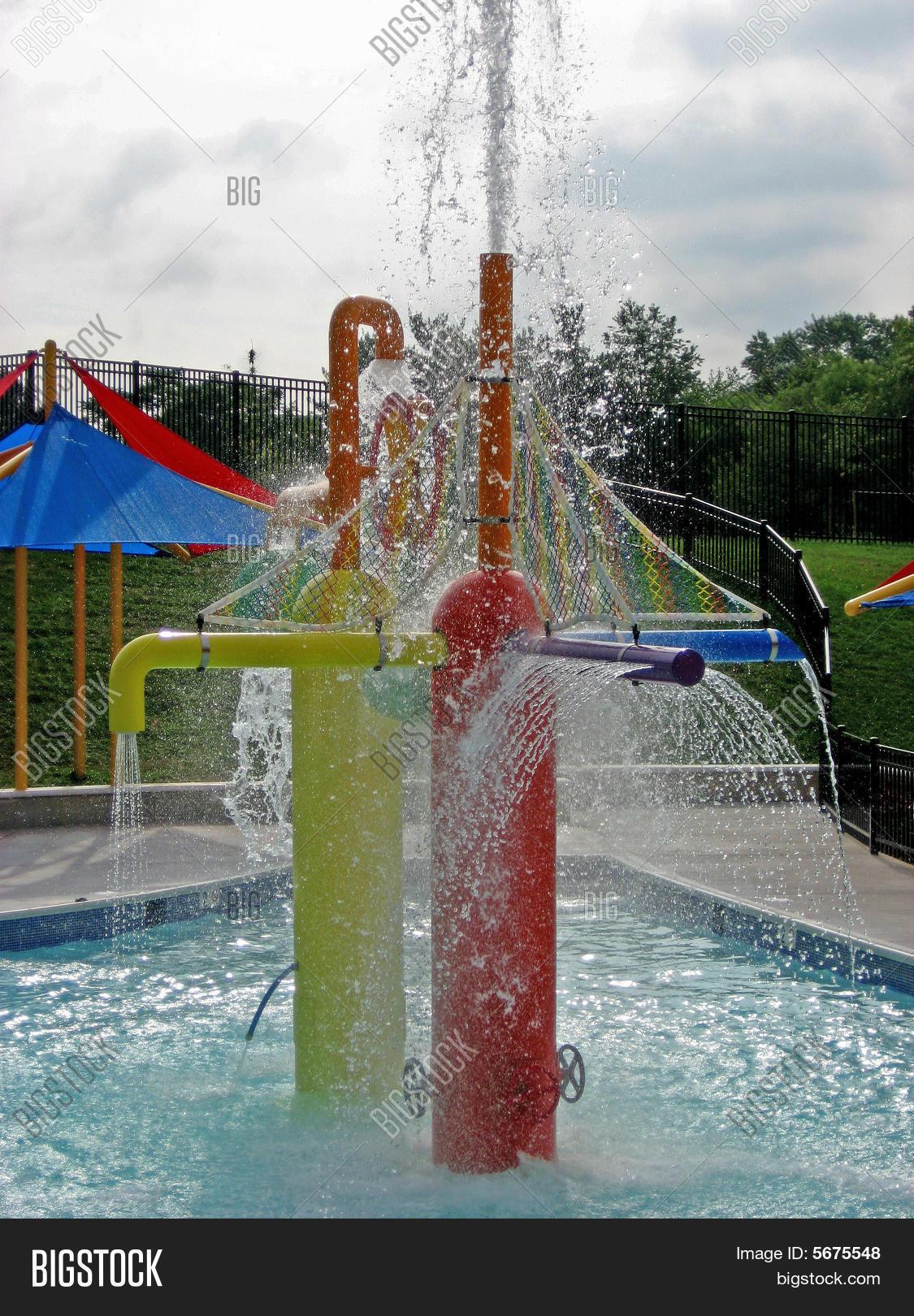 swimming pool sprinkler fun image photo bigstock