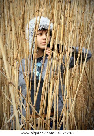 Girl In Reed