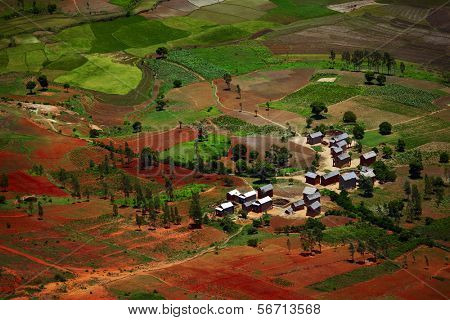 Traditional Malagasy village among red soils. Madagascar
