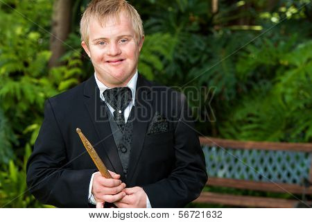 Disabled Musician In Black Suit.
