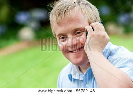 Handicapped Boy Talking On Cell Phone.