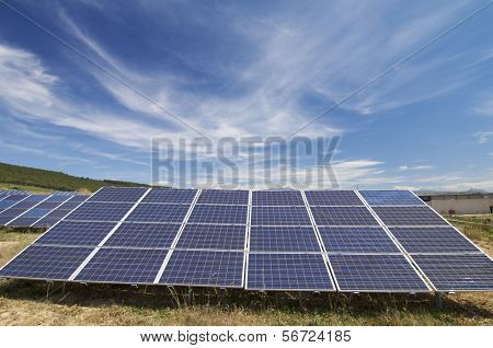 solar field with cloudy sky