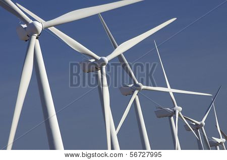 windmills group with blue sky