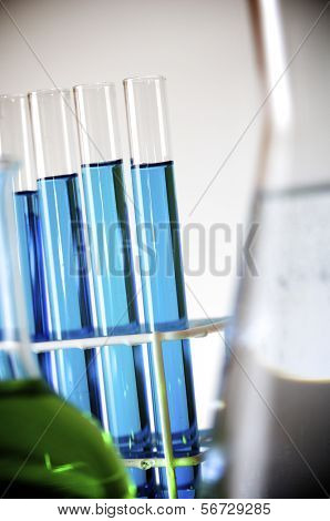test tubes with blue liquid in a laboratory