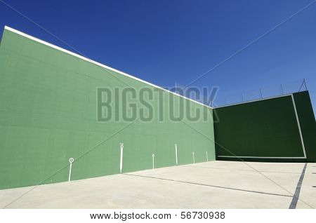 traditional view of Spanish fronton with blue sky