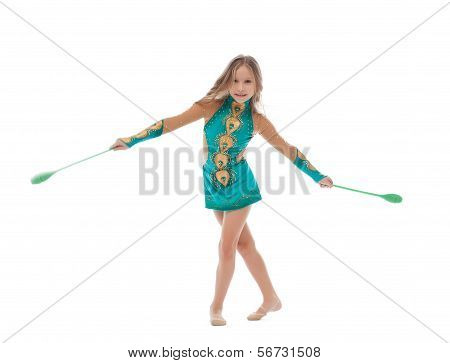 Smiling artistic gymnast performs with mace